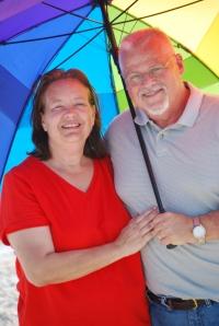 Dad under an umbrella with Mom