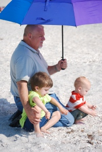My Dad shading the boys at the beach